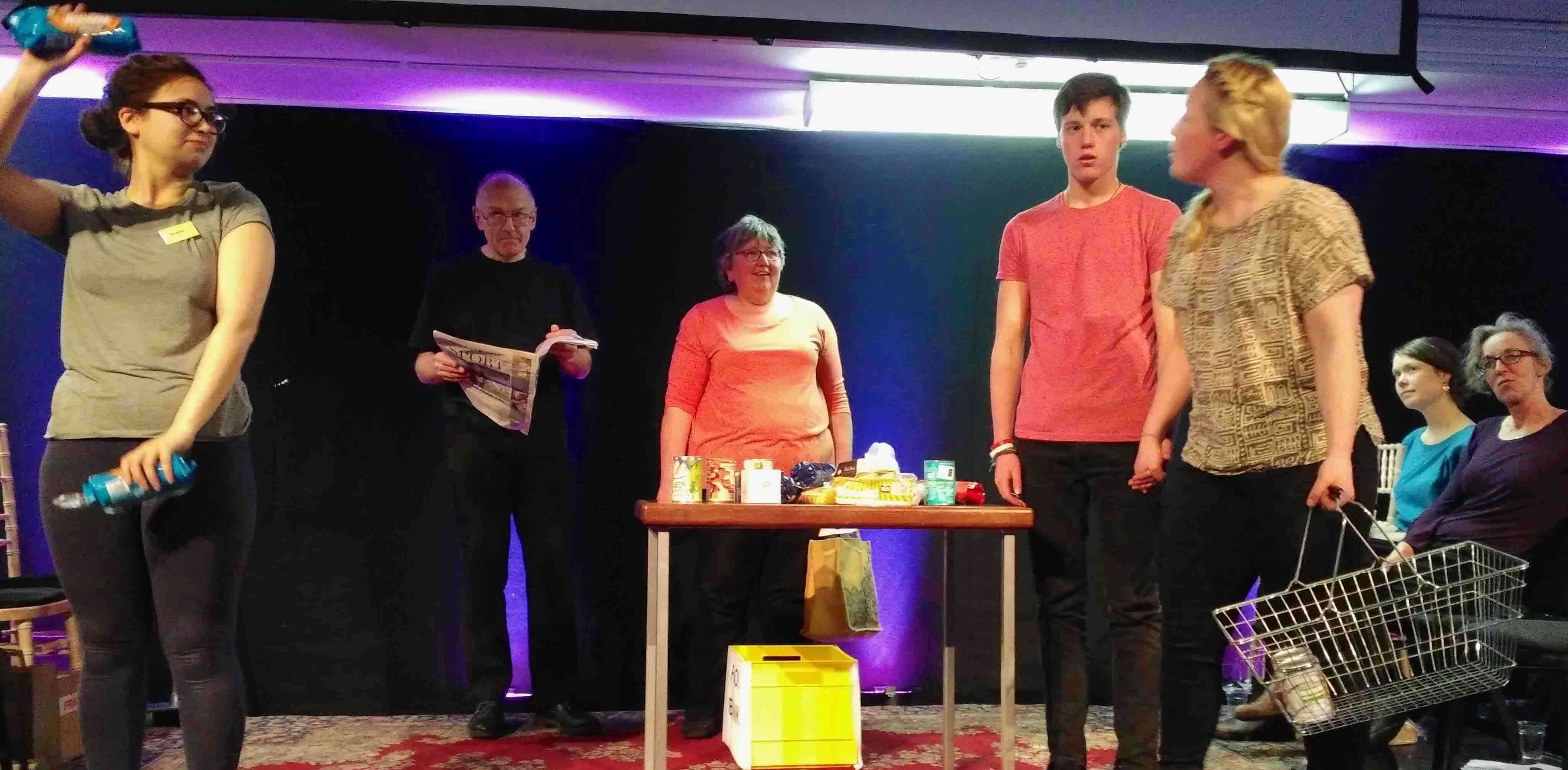 A picture of the play, portraying Sally in the supermarket