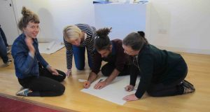 Participants of Turning the Tables writing down their thoughts