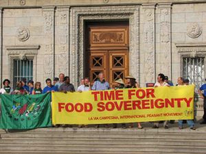"Activists with banner ""Time for Food Sovereignty"""